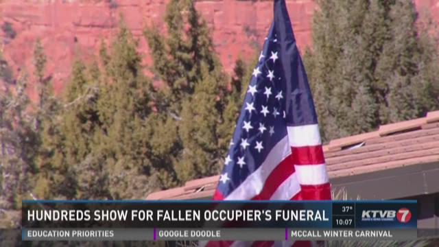 Hundreds show for fallen occupier's funeral