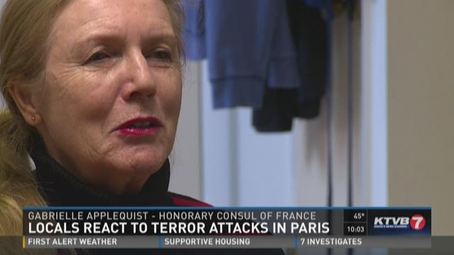 Philippe Didier watches coverage of the terror attacks in Paris.
